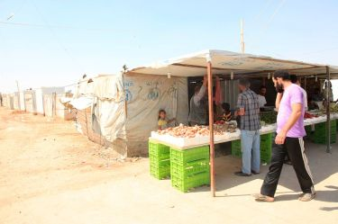 Zaatari is equivalent to Jordan's fourth largest city in terms of population, and now has over 3,000 small businesses set up by the refugees themselves, selling everything from fruit and veg to roast chicken and bridal wear. / Photo by Russell Watkins/Department for International Development