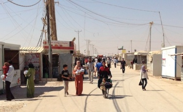 Walking along the 'Champs Elysees', the main street in the Zaatari refugee camp for Syrian refugees in Jordan / Photo by the FCO